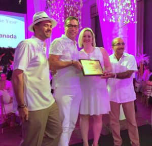 SITE Canada president John Crowe and immediate past-president Hayley Bishop accept the SITE Chapter of the Year Award from Kevin Hinton (far left), chief excellence officer, SITE, and Rajeev Kohli, SITE president (far right).